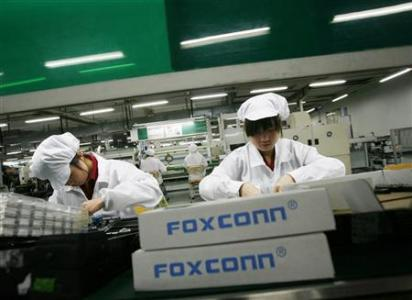 Employees work inside a Foxconn factory in the township of Longhua in the southern Guangdong province in this May 26, 2010 file photo