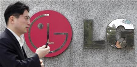 A man walks past the headquarters of LG Electronics in Seoul