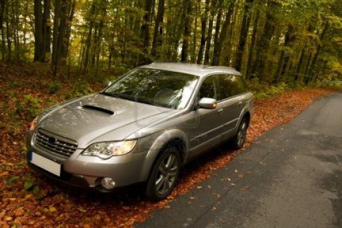 4145372-car-parking-in-the-autumn-forest
